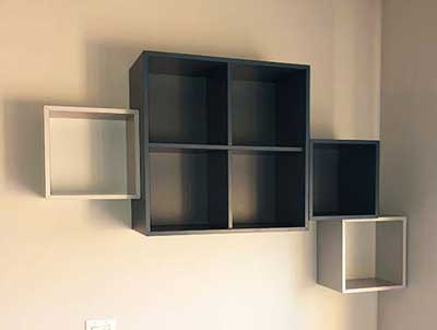 Ikea Besta Unit entertainment center mounted to wall