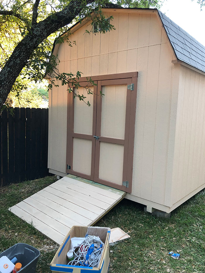 outside shed painted cream with light brown trim