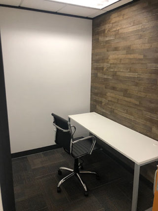 Small office painted white, furniture added