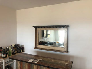 200lb wooded mirror mounted to the wall