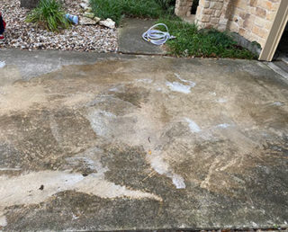 A dirty driveway made of concrete
