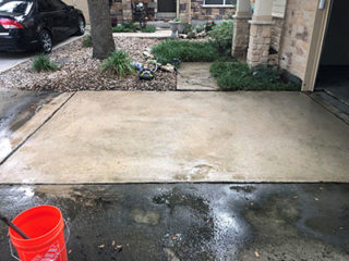 Pressure wash a driveway made of concrete