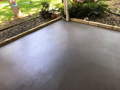 Backyard-patio-painted-with-textured-paint