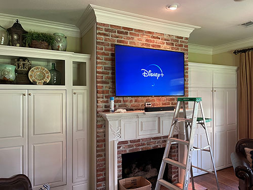 Brick-Fire-Place-WhitA-TV-Mounted-(After)