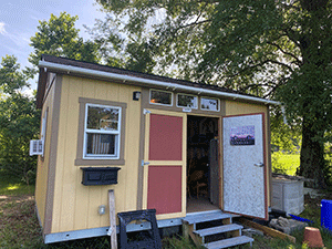 Install a gutter system on a small shed