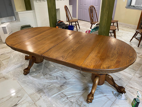 WOOD TABLE IN THE PROCESS OF BEING REFINISHED (BEFORE)